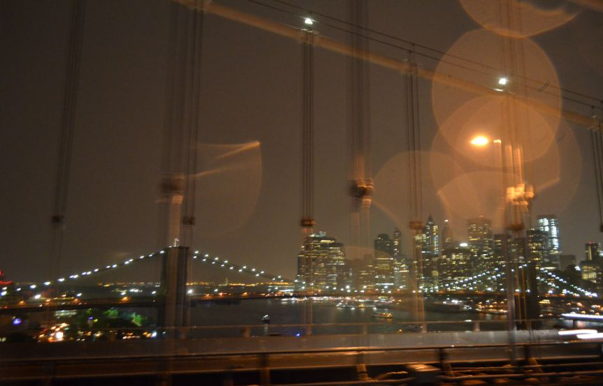 View of the (wet) city from the Manhattan Bridge